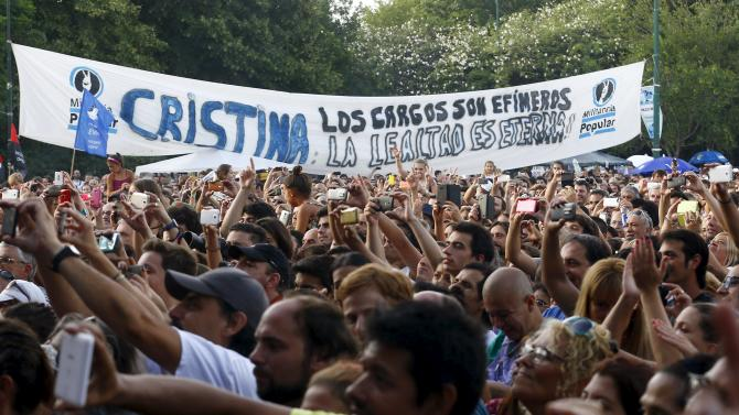 People gather in support for former Argentine president Cristina Fernandez de Kirchner during an anti-government festival organised by a group of artists in a public park in Buenos Aires
