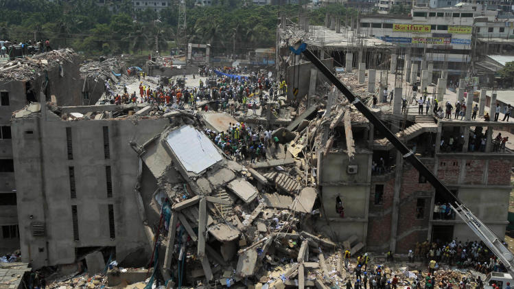 Bangladesh rescuers look for survivors and victims at the site of a building that collapsed Wednesday in Savar, near Dhaka, Bangladesh,Thursday, April 25, 2013. By Thursday, the death toll reached at least 194 people as rescuers continued to search for injured and missing, after a huge section of an eight-story building that housed several garment factories splintered into a pile of concrete. (AP Photo/A.M.Ahad)