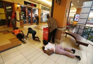 People scramble for safety as armed police hunt gunmen who went on a shooting spree at Westgate shopping centre in Nairobi