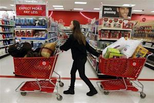 """A woman pulls shopping carts through the aisle of a Target store on the shopping day dubbed """"Black Friday"""" in Torrington"""