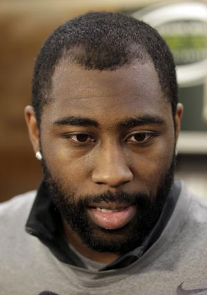FILE - In this Thursday, May 10, 2012 file photo, New York Jets cornerback Darrelle Revis talks to the media near his locker at the team's football training facility,  in Florham Park, N.J. Revis and the New York Jets appear on the verge of parting ways. A person familiar with the situation told The Associated Press on Sunday, April 21, 2013, that the Jets granted Revis permission to take a physical and negotiate a contract with the Tampa Bay Buccaneers, signaling a trade is imminent. (AP Photo/Julio Cortez, File)