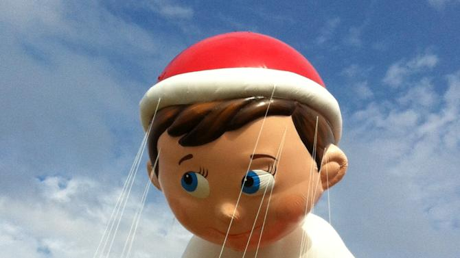 FILE - In this Nov. 10, 2012 file photo provided by Macy's, the Elf on the Shelf balloon floats over the Meadowland's race track during a test flight in East Rutherford, N.J. The Elf on a Shelf is one of three new balloons to be featured in the 2012 Macy's Thanksgiving Parade. (AP Photo/Macy's, Inc.)