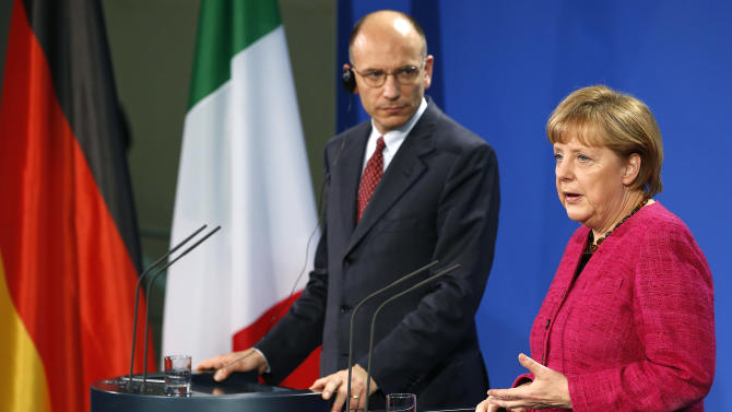 "German Chancellor Angela Merkel, right, and the Prime Minister of Italy, Enrico Letta, left, address the media during a press conference as part of a meeting at the chancellery in Berlin, Germany, Tuesday, April 30, 2013. Italy's prime minister is urging the European Union to drop its insistence on austerity policies and promote initiatives fostering growth instead. Prime Minister Enrico Letta said Tuesday in Germany ""it is absolutely necessary"" to foster growth and job creation to help the 27-nation bloc's stalling economies ""so that our citizens see Europe not as something negative but as something positive.""  (AP Photo/Michael Sohn)"