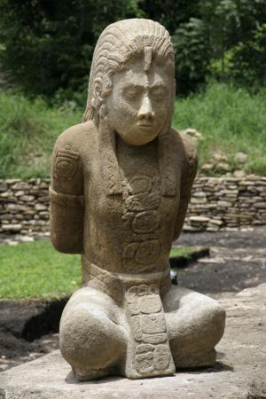 One of two pre-hispanic stone sculptures that were recently found in the archeological site of Tonina, near Ocosingo, southern Mexico is seen Wednesday, July 6, 2011.  According to Mexico's National Institute of History and Anthropology, INAH, the 1,300-year-old limestone sculptures of captured Mayan warriors could shed light on the alliances and wars among Mayan cities during the civilization's twilight. (AP Photo/Moyses Zuniga)