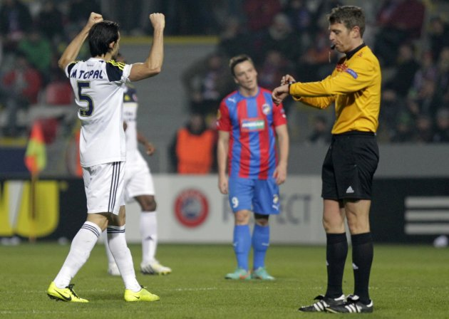 Topal of Fenerbahce celebrates his team's victory over Viktoria Plzen in their Europa League match in Plzen