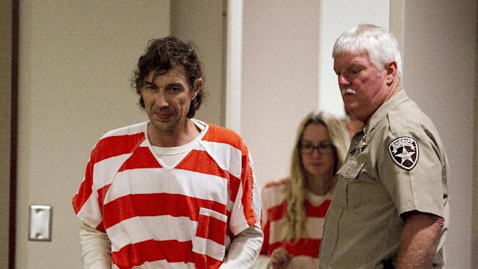 Paul Comer and his wife Sheila are led into a courtroom for a hearing in Dallas, Ga., Thursday, Oct. 4, 2012. The Comer's  are accused of locking their teenaged son in a bedroom with little food for years. Their request for bond was denied. (AP Photo/John Bazemore)