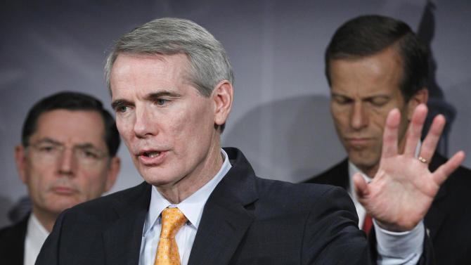 """Sen. Rob Portman, R-Ohio, center, with Sen. John Barrasso, R-Wyo, left, and Sen. John Thune, R-S.D. speaks during a news conference on Capitol Hill in Washington, Thursday, Nov. 3, 2011, to call for Senate action on the jobs bills, known as the """"Forgotten 15"""" passed by the Republican-led House of Representatives.  (AP Photo/Manuel Balce Ceneta)"""