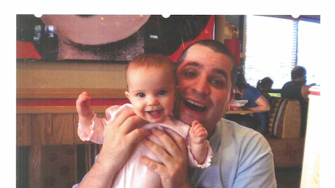 This undated photo submitted into evidence by defense attorney Julia L. Gatto shows New York City police Officer Gilberto Valle with his daughter. A jury is beginning its first full day of deliberations, Friday, March 8, 2013, in the case against Valle, who is accused of conspiring to kidnap, kill and cannibalize as many as six women that he knew, including his wife. If convicted, he could face life in prison. (AP Photo/Provided by Attorney Julia L. Gatto)