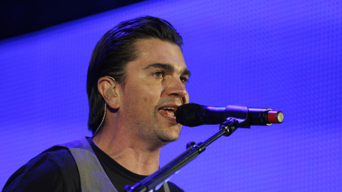 Colombian singer-guitarist, Juanes, performs in Seattle, on Thursday, March 10, 2011, in Seattle, Wash. It was the start of his world tour. (AP Photo/Kevin P. Casey)