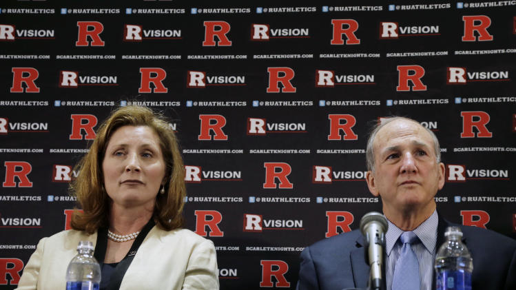 FILE - In this May 15, 2013 file photo, Julie Hermann, left, sits with Rutgers president Roberet L. Barchi, as they listen to a question during a news conference where she was introduced as the new athletic director at Rutgers University in Piscataway, N.J. A high ranking official at the University of Tennessee has voiced her support for Hermann, who is facing allegations she verbally abused players while she was the volleyball coach with the Volunteers. (AP Photo/Mel Evans, File)
