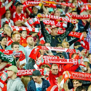 Liverpool fans stage walkout over ticket prices