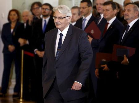 Foreign Minister Witold Waszczykowski walks to receive his nomination from Poland's President Andrzej Duda during a government swearing-in ceremony at the Presidential Palace in Warsaw