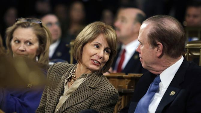 FILE - In this Tuesday, Jan. 8, 2013 file photograph, New Jersey state Sen. Barbara Buono, center, D-Edison, who has announced that she will challenge the first-term Republican Gov. Chris Christie, in November, talks with Assemblyman Patrick J. Diegnan, right, D-South Plainfield, at the Statehouse in Trenton, N.J. On Tuesday, Jan. 29, 2013, Buono picked up endorsements from the Democratic Governors' Association, southern New Jersey's seven county Democratic Party chairs, and the southern legislative delegation, thereby sewing up enough support statewide to become the Democrats' presumptive nominee for governor. (AP Photo/Mel Evans, File)