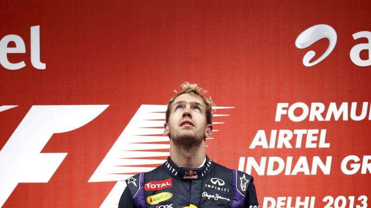 Red Bull Formula One driver Vettel looks up before being presented with the winner's trophy after the Indian F1 Grand Prix at the Buddh International Circuit in Greater Noida