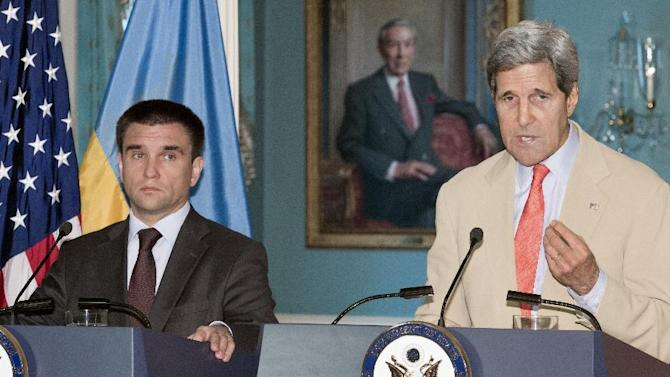 US Secretary of State John Kerry delivers remarks with Ukrainian Foreign Minister Pavlo Klimkin during a press conference on July 29, 2014 in Washington, DC