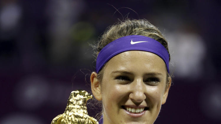 Belarus' Victoria Azarenka displays the trophy, after her victory against Serena Williams of the US, in the final match of the Qatar WTA Ladies Open tennis tournament, in Doha, Qatar, Sunday, Feb. 17, 2013. (AP Photo/Osama Faisal)