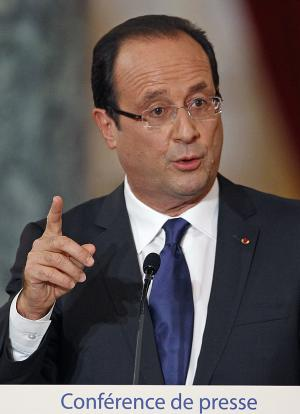French President Francois Hollande addresses reporters during a press conference held at the Elysee Palace in Paris, Tuesday Nov.13, 2012.  Francois Hollande gave a wide-ranging press conference about his much-criticized presidency so far.(AP Photo/Remy de la Mauviniere)
