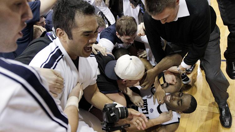 Butler forward Roosevelt Jones tries to get off the floor during celebrations after he made the game-winning basket against Gonzaga in an NCAA college basketball game Saturday, Jan. 19, 2013, in Indianapolis. Butler won 64-63. (AP Photo/AJ Mast)