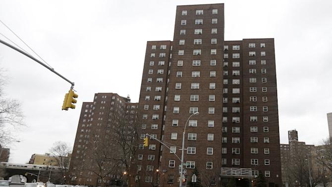 This Wednesday, March 6, 2013 photo shows the apartment building at 1475 Madison Avenue in New York. Officials want to demolish existing areas on public housing properties _ a baseball field, a community center, a parking lot _ and build more than half a dozen brand-new luxury apartment complexes. (AP Photo/Frank Franklin II)