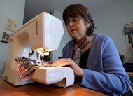 Christine Crawford, 64, who suffers from chronic illness, works in her sewing studio which she converted from a dinning room in Ottawa on Thursday, December 12, 2013. THE CANADIAN PRESS/Sean Kilpatrick