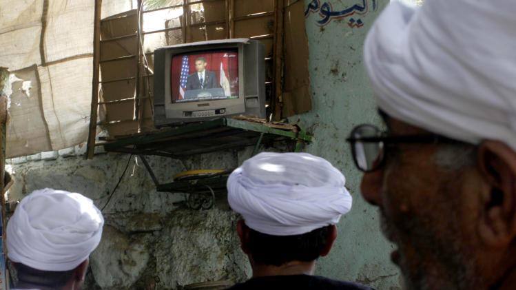 FILE - In this June 4, 2009 file photo, Egyptian villagers watch a live broadcast of a speech by U.S. President Barack Obama is seen on screen at a coffee shop in Qena, south Cairo, Egypt when he was calling for a new beginning between the United States and Muslims in his speech delivered at Cairo University in Egypt. Many in the Mideast also would like to see Obama win a second term, though they feel he has not lived up to his Cairo speech, in which he extended a hand to the Islamic world by calling for an end to the cycle of suspicion and discord. (AP Photo/File)
