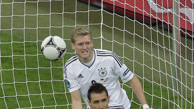 Germany's Miroslav Klose, front, and teammate Andre Schuerrle look to the linesman after their goal was disallowed during the Euro 2012 soccer championship quarterfinal match between Germany and Greece in Gdansk, Poland, Friday, June 22, 2012. (AP Photo/Gero Breloer)