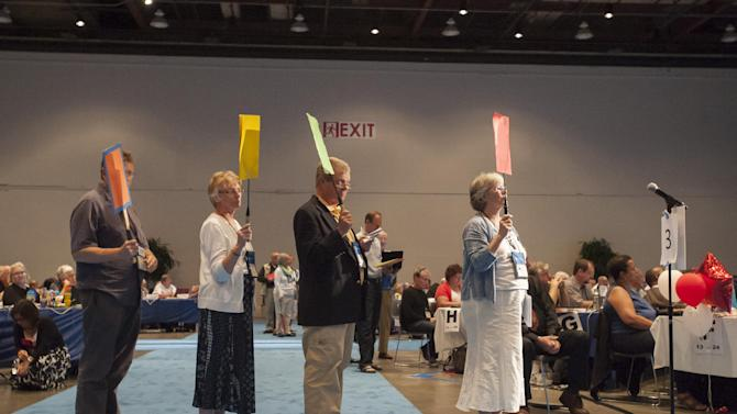 "Commissioners and advisors wait in line to debate a vote on whether the church should recognize same-sex marriage at the 221st General Assembly of the Presbyterian Church at Cobo Hall, in Detroit, Thursday, June 19, 2014. The top legislative body of the Presbyterian Church (U.S.A.) voted by large margins to recognize same-sex marriage as Christian in the church constitution, adding language that marriage can be the union of ""two people,"" not just ""a man and a woman."" (AP Photo/The Detroit News, David Guralnick)"