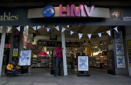 A worker opens a branch of HMV at the start of the day on Oxford Street in London, Tuesday, Jan. 15, 2013. British music and entertainment retailer HMV admitted defeat on Tuesday after more than 90 years on the U.K high street, suspending trading in its shares and calling in administrators to try to salvage any viable parts of the business. HMV is the last big retail chain selling recorded music in Britain and employs more than 4,000 people working in 238 stores, which will remain open for the time being. The company&#39;s management confirmed that it had failed to gain agreements with lenders and suppliers to continue trading. (AP Photo/Matt Dunham)