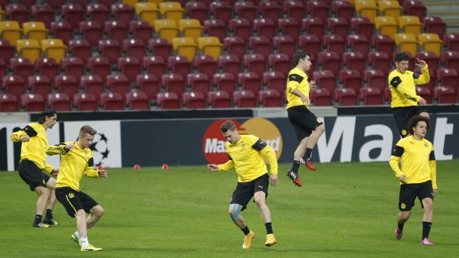 Borussia Dortmund's players warm up during a training session, a day before their Champions League soccer match against Galatasaray