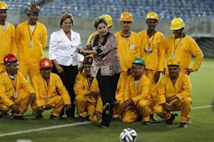 Brazil's President Roussef kicks the ball during the opening ceremony of the Arena das Dunas stadium in Natal