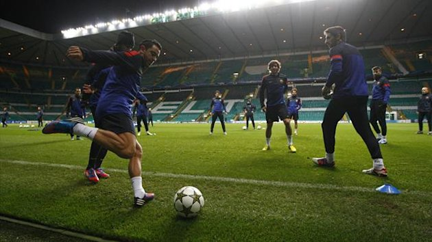 Barcelona's Xavi kicks a ball during a training session ahead of their Champions League match against Celtic at Celtic Park (Reuters)