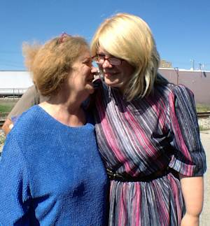 Kristine Bunch, right, hugs her mother Susan Hubbard, after being released in Greensburg, Ind., Wednesday, Aug. 22, 2012, for the first time after16 years in prison.  Bunch was convicted of setting a 1995 fire that killed her 3-year-old son, but is free on bail as she awaits a new trial. (AP Photo/The Indianapolis Star, Charlie Nye)  NO SALES