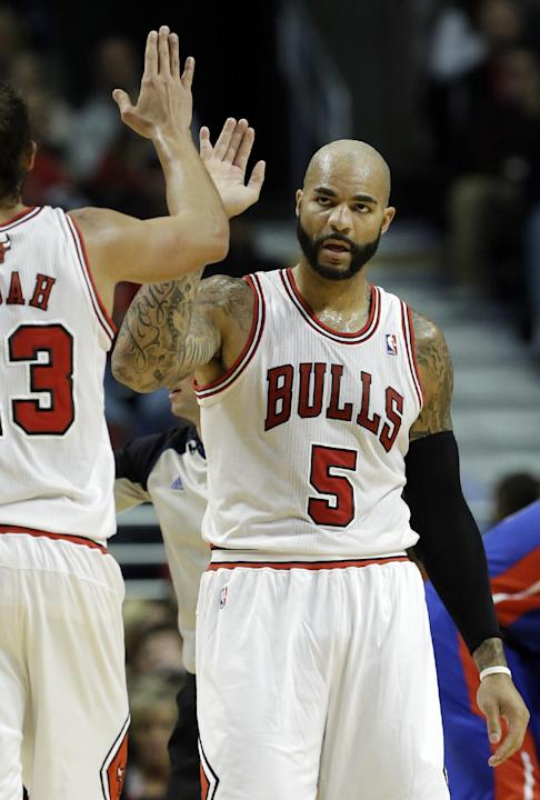 Chicago Bulls forward Carlos Boozer, right, celebrates with center Joakim Noah after getting three free-throw shots during the first half of an NBA preseason basketball game against the Detroit Piston