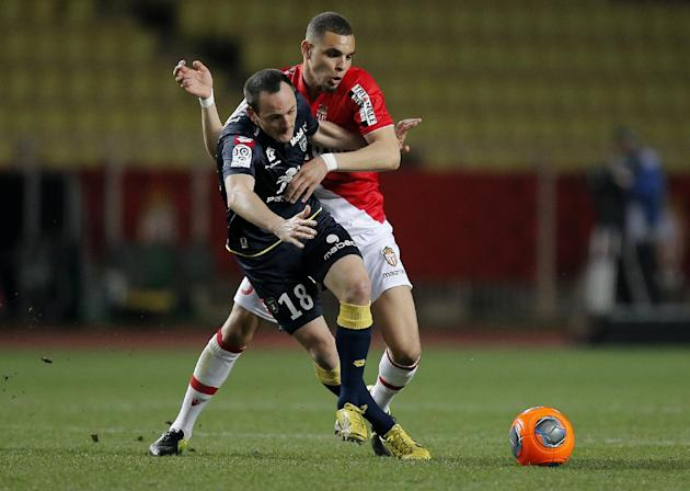 Monaco's Layvin Kurzawa of France, right, challenges Sochaux player Sebastien Roudet of France during their French League One soccer match, in Monaco stadium, Saturday March 8, 2014