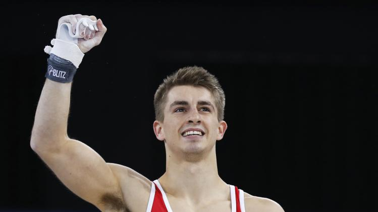 England's Whitlock celebrates after competing in men's All-Around Artistic Gymnastics at 2014 Commonwealth Games in Glasgow