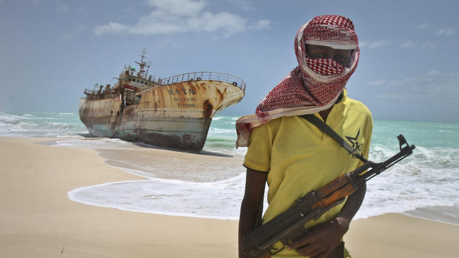 In this photo taken Sunday, Sept. 23, 2012, masked Somali pirate Hassan