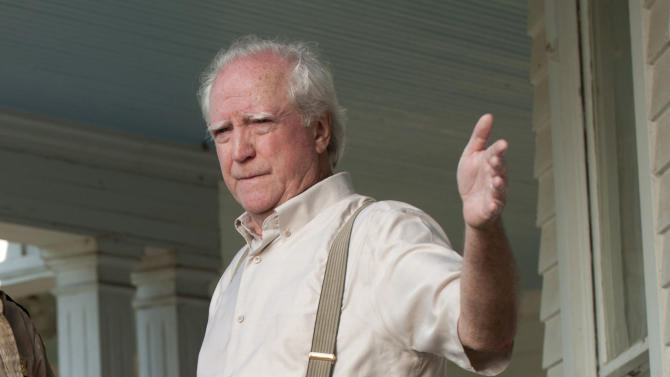 """In this image released by AMC, actor Scott Wilson appears in a scene from the second season of the AMC original series, """"The Walking Dead,"""" in Senoia, Ga. Peachtree City police arrested 70-year-old Scott Wilson on Aug. 18, 2012 after someone called 911 to report a Chrysler PT Cruiser driving erratically. On the AMC drama, Wilson plays a farmer and recovering alcoholic who's part of a band of survivors after a zombie apocalypse. (AP Photo/AMC, Gene Page)"""