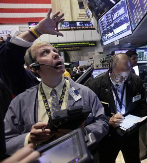 FILE -- In a July 31, 2012 file photo trader Richard Cohen, left, works on the floor of the New York Stock Exchange.  U.S. stocks dawdled between small gains and losses Thursday Aug. 9, 2012.   (AP Photo/Richard Drew, file)