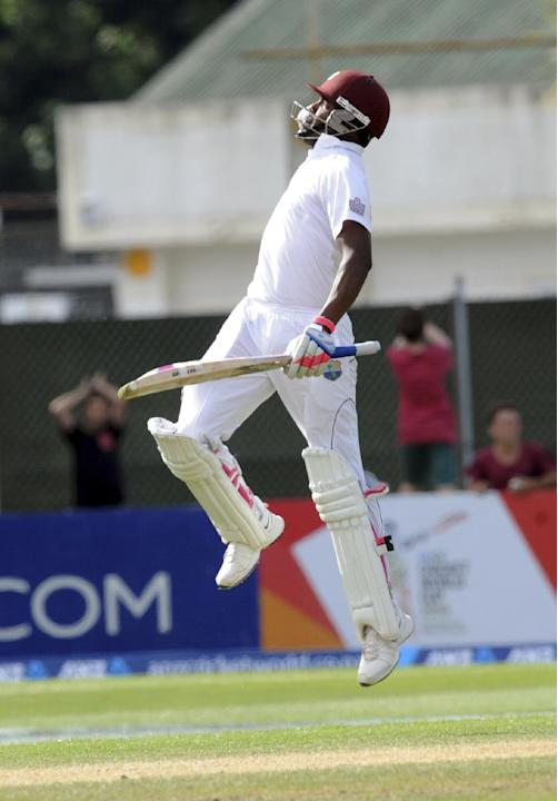 West Indies Darren Bravo leaps in the air as he celebrates his double century against New Zealand on the fourth day of the International cricket match at University Oval in Dunedin, New Zealand, Frida