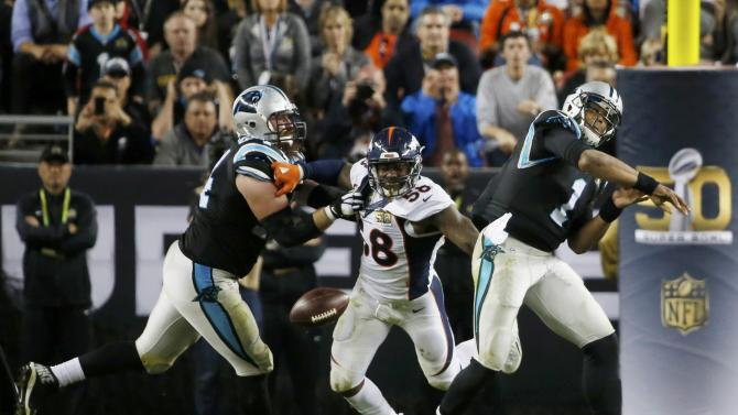 Denver Broncos' Von Miller strips the ball away from Carolina Panthers' quarterback Cam Newton during the fourth quarter of the NFL's Super Bowl 50 football game in Santa Clara