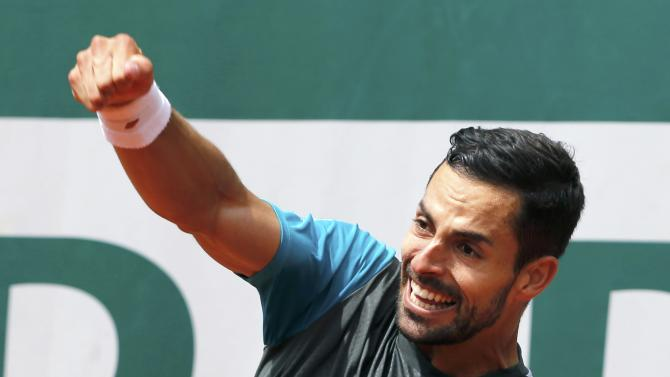Santiago Giraldo of Columbia reacts during the men's singles match against David Goffin of Belgium at the French Open tennis tournament at the Roland Garros stadium in Paris