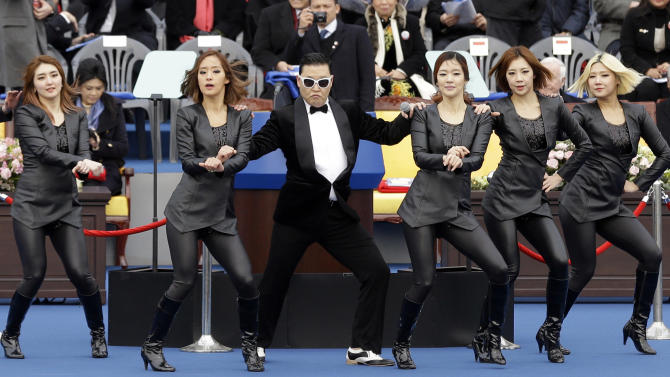 "FILE - In this Monday, Feb. 25, 2013 file photo, South Korean rapper PSY, third left, performs with dancers before the inauguration ceremony of President Park Geun-hye at the National Assembly in Seoul, South Korea. South Korean rapper PSY is unveiling his much-awaited follow-up to ""Gangnam Style"" next month and celebrating it with a huge concert in Seoul. PSY made the announcement Friday, March 8, on YouTube where his Gangnam Style music video has a record 1.39 billion views. PSY says he will release the new single and hold the concert at a soccer stadium both on April 13. (AP Photo/Lee Jin-man, File)"