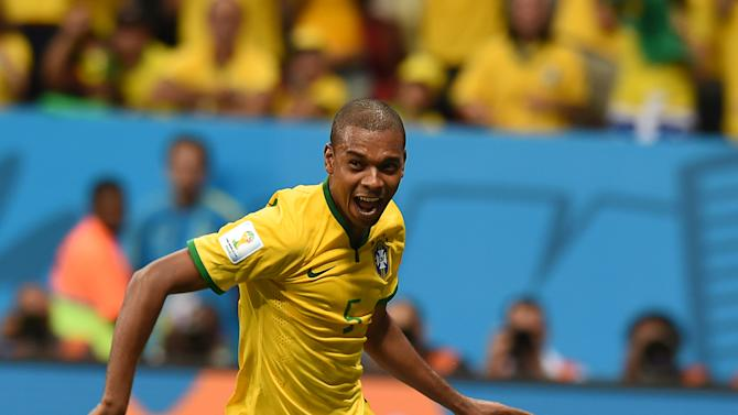 Brazil's midfielder Fernandinho celebrates after scoring their fourth goal during the Group A football match between Cameroon and Brazil at the Mane Garrincha National Stadium in Brasilia during the 2014 FIFA World Cup on June 23, 2014