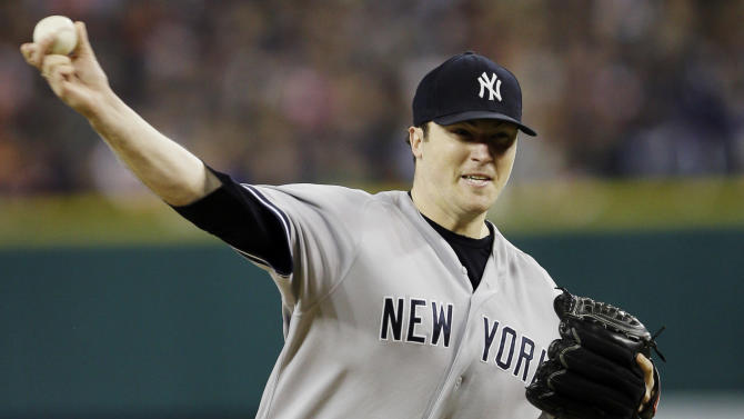 New York Yankees' Phil Hughes throws in the second inning during Game 3 of the American League championship series against the Detroit Tigers Tuesday, Oct. 16, 2012, in Detroit. (AP Photo/Matt Slocum)