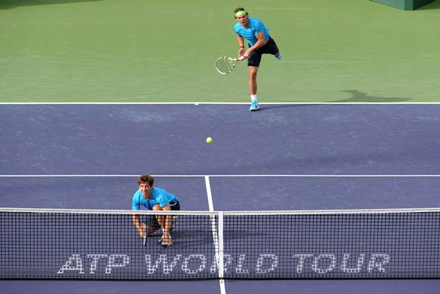 Rafael Nadal And Marc Lopez Of Spain Serve Getty Images
