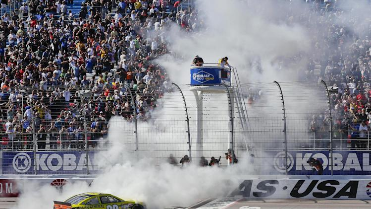 Driver Matt Kenseth performs a burnout at the finish line after winning the NASCAR Sprint Cup Series auto race, Sunday, March 10, 2013 in Las Vegas. (AP Photo/Julie Jacobson)