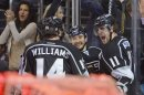 Los Angeles Kings center Anze Kopitar (11) celebrates with right wing Justin Williams (14) and defenseman Slava Voynov (26) after scoring in the second period during Game 5 of the Western Conference semifinals in the NHL hockey Stanley Cup playoffs, Thursday, May 23, 2013, in Los Angeles. (AP Photo/Mark J. Terrill)