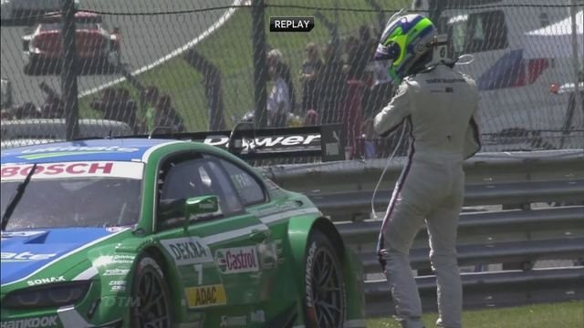 Rockenfeller wins German Touring Car Masters race at Brand's Hatch.