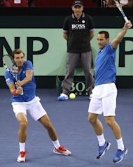 France's Julien Benneteau (L) and Michael Llodra during their Davis Cup match against Israel on February 2, 2013. The French duo won 7-6 (7/3), 6-1, 6-0 in the doubles to cement an insurmountable 3-0 lead in the tie