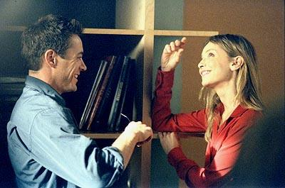 "Ally (Calista Flockhart, R) seeks relationship advice from Larry Paul (Robert Downey Jr. L), a mysterious stranger who has a knack for understanding her complexities, in the ""Sex, Lies and Second Thoughts"" episode of Ally McBeal Ally McBeal"